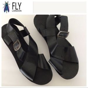 FLY LONDON BLACK LEATHER CROSS STRAP WEDGE…